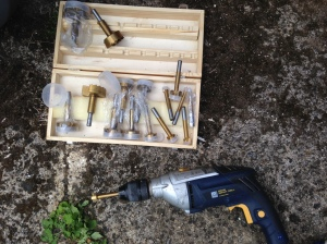 With these cool tools that my dad has that drill a wide hole with a flat bottom!